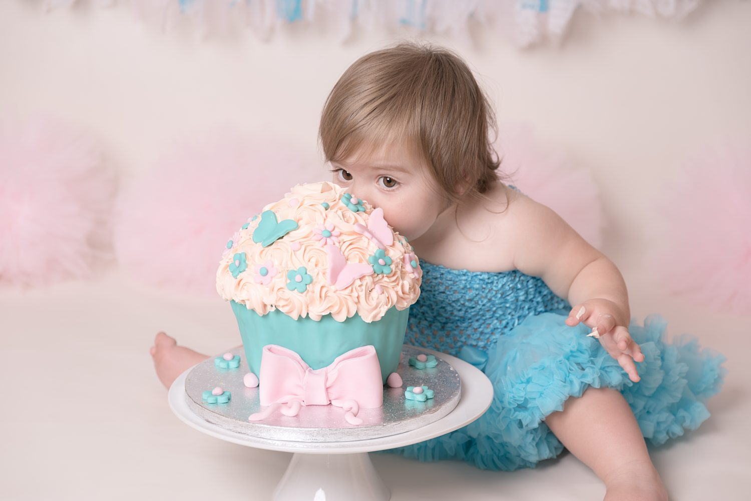 little girl enjoying a cake
