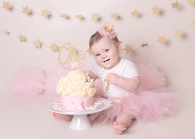 cute baby girl with cake