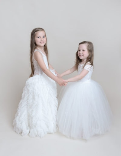 2 girls playing during a photo shoot