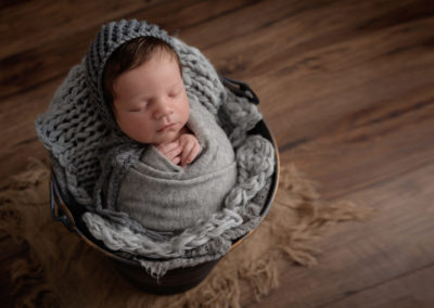 baby wrapped up for a newborn shoot