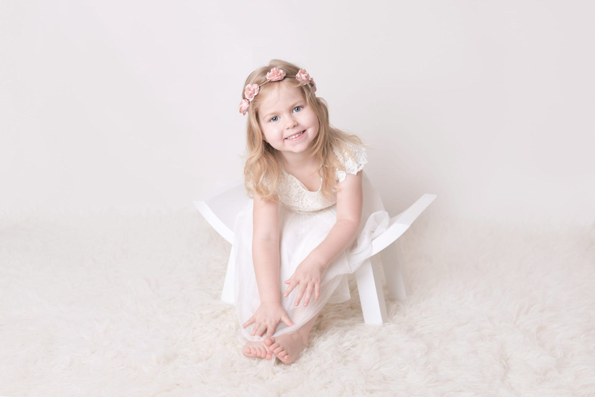 big sister wearing a lovely dress smiling for her photo