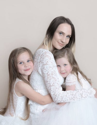 mum and her 2 girls in a photo shoot