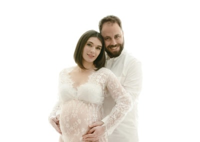 mum and dad having a maternity shoot